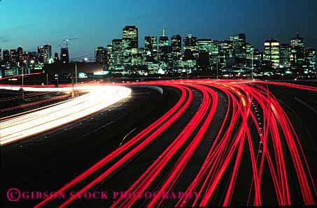 Stock Photo #2289: keywords -  abstract blur bright california car cityscape commute congestion curve distort downtown drive dusk exposure francisco freeway highway horz hour interstate light long motion movement night red road rush san skyline streaks street time traffic transportation vehicle