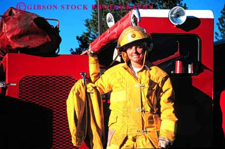 Stock Photo #2305: keywords -  building burning career caution danger emergency female fight fire firewoman horz income job male occupation public released risk role safety service suit truck uniform vocation woman work yellow young