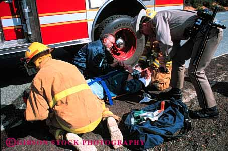 Stock Photo #2306: keywords -  accident aid care career emergency firemen first horz income injury job medical occupation police public safety service suit treat uniform victim vocation work