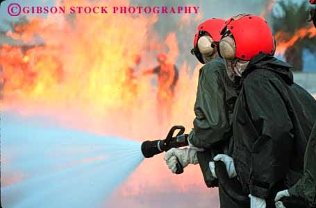 Stock Photo #2318: keywords -  burn cooperate danger è education emergency fire firemen flame gear heat horz hose hot injury learn navy practice protective risk suit team train training water