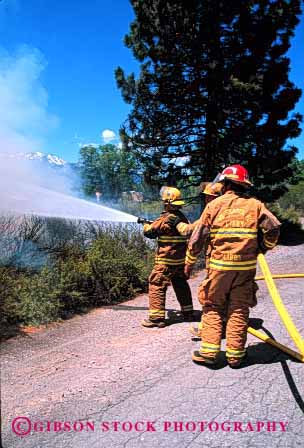 Stock Photo #2323: keywords -  air brush career cooperate emergency fight fire firefighter fireman firemen hose job pollution public service smoke team vert vocation water wildfire work