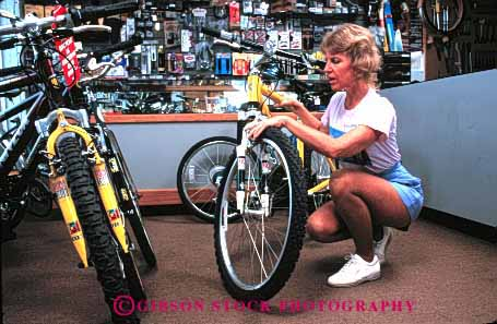Stock Photo #2339: keywords -  alone bicycle bike buy examine female horz mountain private purchase relax released retail sell shopping store study summer woman