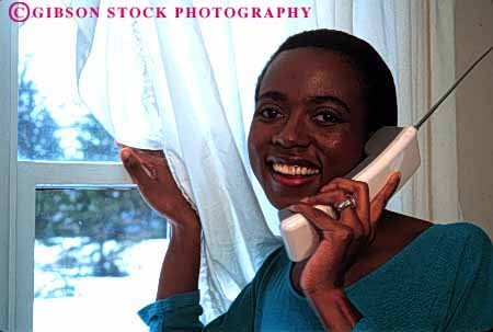 Stock Photo #2341: keywords -  african alone american black communication cordless ethnic female happy home horz house minority outdoor phone private relax released smile summer talk telephone window woman