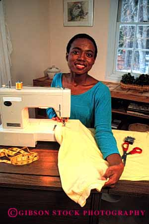 Stock Photo #2370: keywords -  african alone american black clothing create equipment ethnic female home indoor machine minority private relax released sew sewing skill vert woman