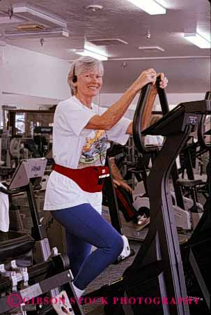Stock Photo #2377: keywords -  conditioning elderly equipment exercise female fitness gym happy health mature old released senior sixties smile strength training trim vert woman workout