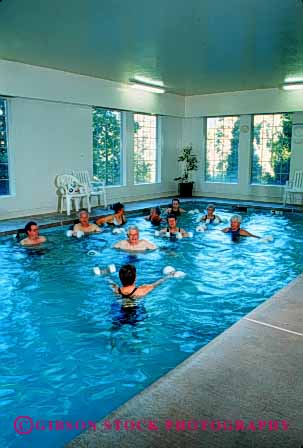 Stock Photo #2381: keywords -  class conditioning elderly exercise female fit fitness health male mature men old pool released senior sixties strength stretch swim training trim vert water wellness women workout