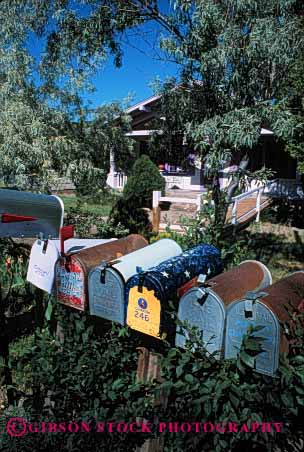 Stock Photo #2383: keywords -  box boxes communicate deliver group letter mail mailbox mailboxes office personalized post rail row rural same sameness vert