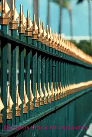 Stock Photo #2386: keywords -  bar barrier fence gold metal paint pattern row security sharp spear steel strong symmetrical vert