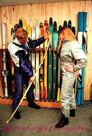 Stock Photo #2411: keywords -  boot business buy buyer colorful consumer couple downhill equipment fitting man merchandise model released shop shopping ski skis snow sport store suit vert winter woman