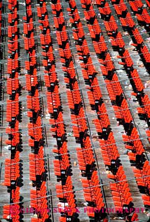 Stock Photo #2414: keywords -  audience empty geometric geometry orange pattern plastic repetition row seat seating seats stadium vert