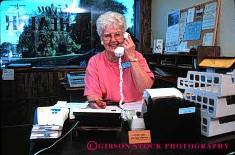 Stock Photo #2422: keywords -  business career commerce communicate desk elderly grandmother horz income job mature occupation office phone reception released senior smile talk telephone vocation volunteer woman work