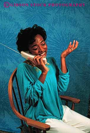 Stock Photo #2424: keywords -  african american black communicate cordless ethnic express female gesture minority phone released smile talk telephone turquoise vert woman