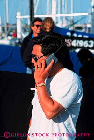 Stock Photo #2428: keywords -  boats business casual cell cellular commerce communicate convey data electronic field in man marina outdoor people person phone phones relax remote report sail talk talking talks technology telecommunication telephone telephones transfer use uses using vert work