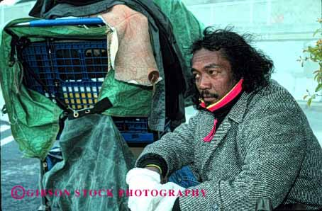 Stock Photo #2435: keywords -  african alone american black broke destitute ethnic homeless horz jobless lonely male man minority poor rejected released sad unemployed