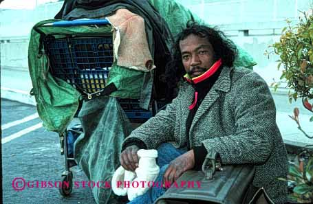 Stock Photo #2436: keywords -  african alone american black broke destitute ethnic homeless horz jobless lonely male man minority poor rejected released sad unemployed