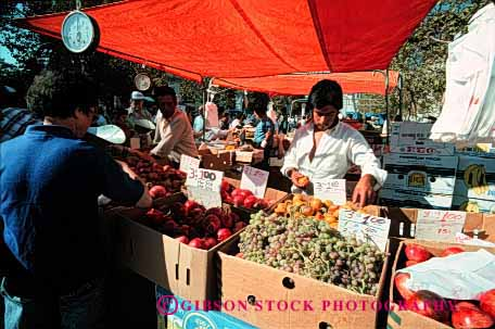 Stock Photo #2448: keywords -  agriculture colorful commerce crop display ethnic farmers food fruit grape horz market merchandise minority produce product retail sell stand vegetable