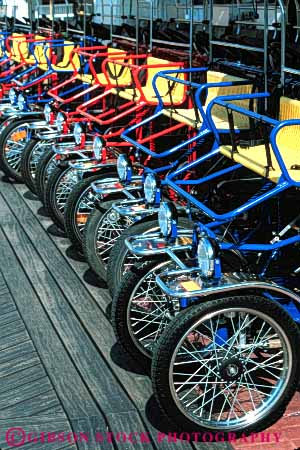 Stock Photo #6137: keywords -  bicycle bicycles bike color colorful disneyworld drive machine pattern peddle rent rental ride roll row symmetrical symmetry vehicle vert wheel wheels