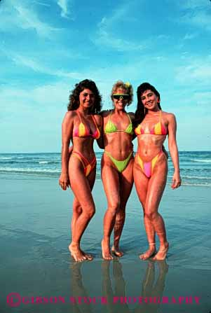 Stock Photo #2464: keywords -  bathing beach bikini female group ocean outdoor relax released sex share sister skin suit summer sun sunbath sunburn sunshine tan tanning together vacation vert warm women