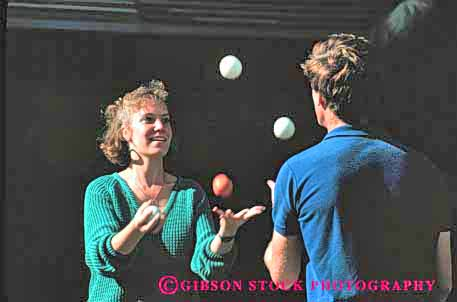 Stock Photo #2467: keywords -  balls coordinate coordination couple horz juggle juggling not practice released share skill team together