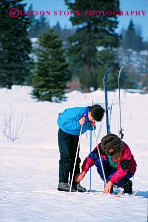 Stock Photo #2471: keywords -  boy child family female help mother nordic parent released single ski snow son sport teach together vert wife winter woman