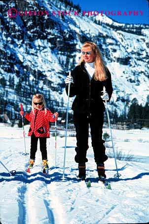 Stock Photo #2480: keywords -  child cooperate daughter family female girl learn mother nordic parent practice recreation released single ski snow sport teach team together vert wife winter woman young