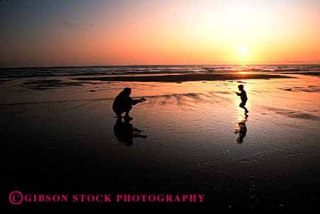 Stock Photo #2493: keywords -  beach child family female horz mother ocean parent play recreation released run silhouette single summer sunrise sunset together vacation warm water wife woman