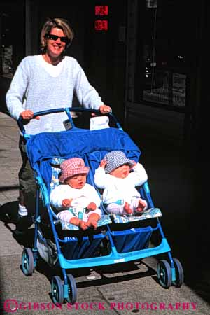 Stock Photo #6136: keywords -  babies baby boy child children daughter enjoy girl identical mom mother offspring outdoor outside parent push share sibling sidewalk single smile son stroller summer together travel trip twins two vacation vert walk wife woman