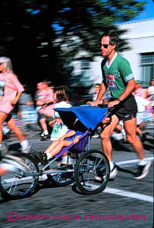 Stock Photo #2498: keywords -  action blur boy child dad daughter father foot girl motion not outdoor parent push race released roll run running single son speed sport stroller together vert wheel