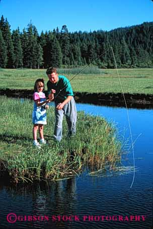 Stock Photo #2505: keywords -  child dad daughter father fish fishing girl help lake learn outdoor parent released single sport stream summer teach together vert