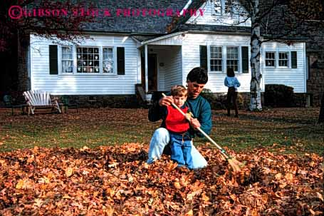Stock Photo #2511: keywords -  assist autumn boy child chore dad effort fall father help home horz house learn leaves outdoor parent rake released son together work