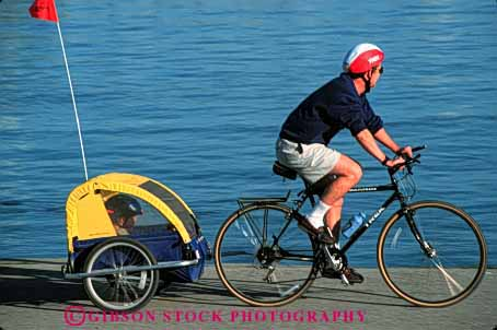 Stock Photo #2512: keywords -  bicycle bike boy child dad father girl horz not outdoor parent pull released single son sport summer team together trailer