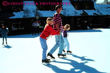 Stock Photo #2513: keywords -  child children dad father girl horz ice learn outdoor parent practice released rink single skate sport sunshine team together winter