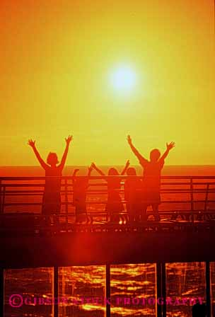 Stock Photo #2514: keywords -  arms children cruise dusk family joy orange parent released ship summer sun sunset vacation vert warm wave
