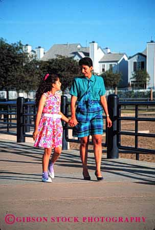 Stock Photo #2521: keywords -  children couple daughter ethnic happy hispanic mexican minority mother parent private released single talk together vert walk