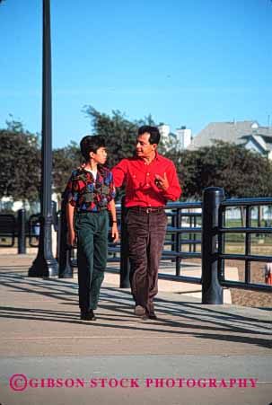 Stock Photo #2524: keywords -  children couple ethnic father happy hispanic mexican minority parent private released single son talk together vert walk