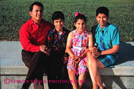 Stock Photo #2525: keywords -  children daughter ethnic families family father group happy hispanic horz mexican minority mother parent portrait released sit son together