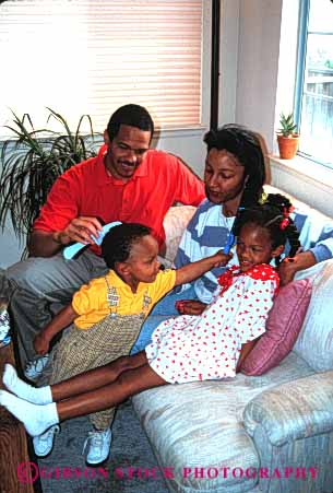 Stock Photo #2526: keywords -  african american black children comb daughter ethnic family father group hair happy home house minority mother parent released son together vert