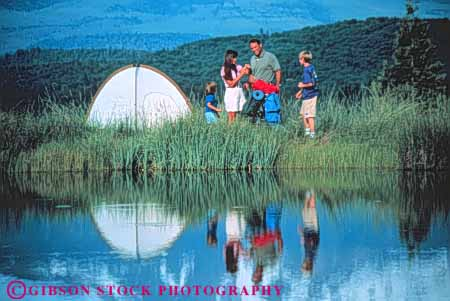 Stock Photo #3361: keywords -  adventure backpacking california camp child cooperation exercise families family father horz husband lake mother mount outdoor reflection released shasta sport summer tent together wife