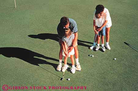 Stock Photo #3372: keywords -  boy brother child cooperate daughter families family father game girl golf horz learn mother outdoor released sister sport summer teach
