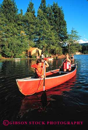 Stock Photo #2539: keywords -  boat boating boats camp camping canoe canoeing canoes child children family kid kids lake paddle recreation released safety summer together vacation vert vest water