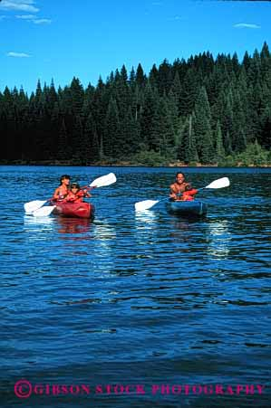 Stock Photo #2540: keywords -  boat child children family father kayak lake mother paddle parent quiet recreation released sport summer together vacation vert water