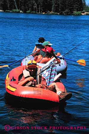 Stock Photo #2546: keywords -  boat child children family father fish fishing inflatable lake mother paddle parent raft recreation relax released summer together vacation vert water