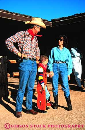 Stock Photo #2551: keywords -  adventure child costume cowboy dude family father guest mother only outfit parent play ranch recreation released son theme together vacation vert west western