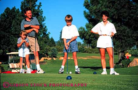 Stock Photo #2553: keywords -  child children daughter family father golf horz learn mother parent play practice recreation released son sport summer teach together warm