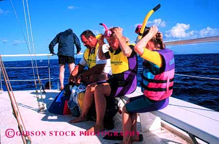 Stock Photo #2560: keywords -  boat child children dive family father flotation hawaii horz mother parent recreation released safety snorkel summer together travel vacation vest warm