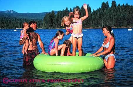 Stock Photo #2562: keywords -  child children family father float girl horz lake mother parent play recreation released summer together vacation warm water