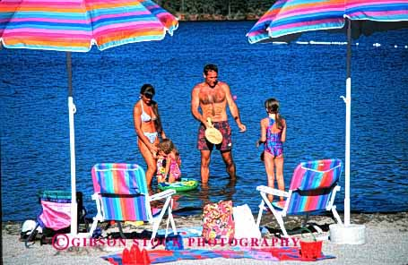 Stock Photo #2568: keywords -  beach child children family father horz lake mother parent play recreation released summer sunshine together umbrella vacation