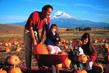 Stock Photo #2572: keywords -  assist autumn california children fall family girl halloween help horz mount outside parent pick pumpkin released share shasta together