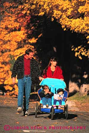 Stock Photo #2575: keywords -  autumn children exercise fall family hike outside released share street stroller together vert walk