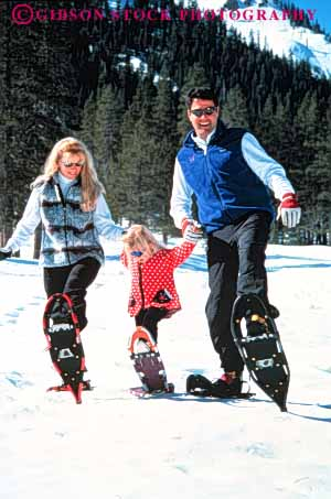 Stock Photo #3374: keywords -  adventure affection child cooperation daughter exercise families family fun girl husband released smile snow snowshoe sport together vert wife winter